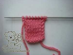 Ring for the pink rose knit ear warmer
