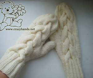 Ready pair of beautiful cable knit mittens