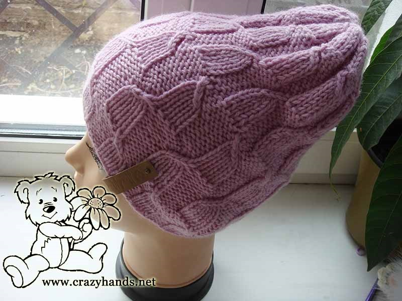 Finished knit magnolia pink hat on the mannequin
