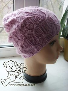 knit magnolia pink hat on the mannequin